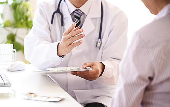 Doctor speaking to patient with a clipboard